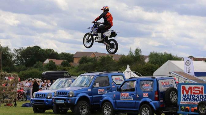 stunt bike jumping car